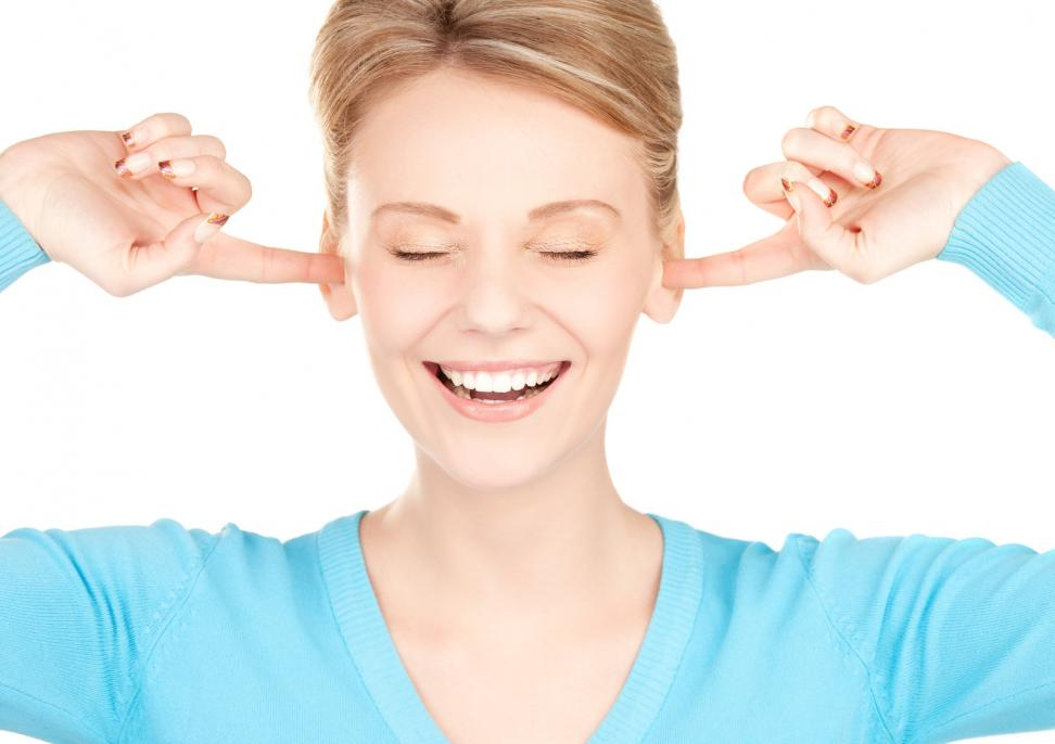 smiling-woman-with-hands-over-ears